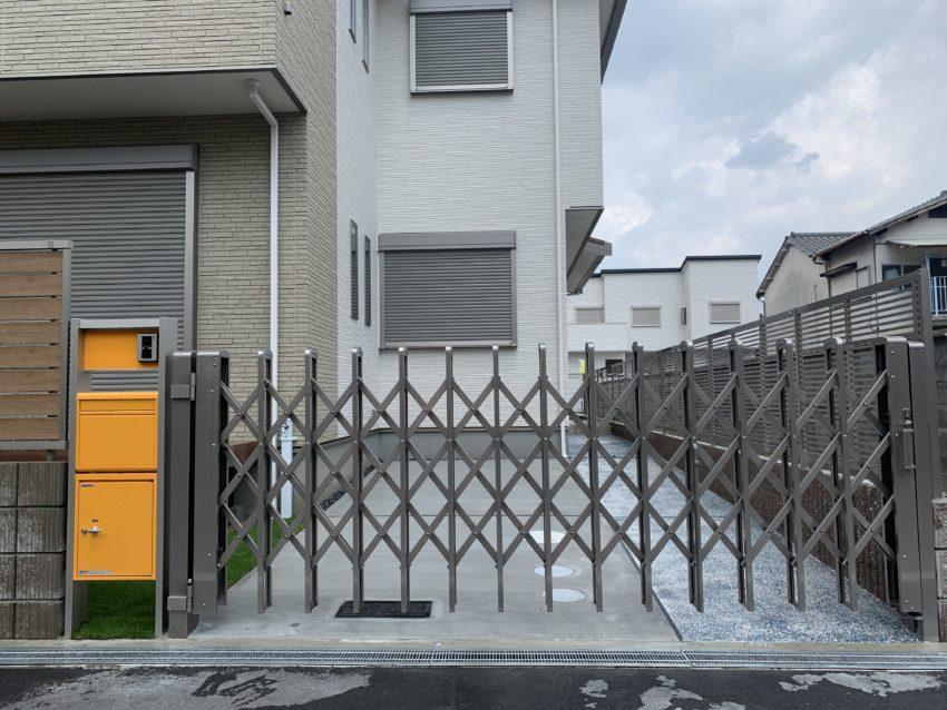 伸縮門扉は四国化成/リフティングアコー1型ワイド